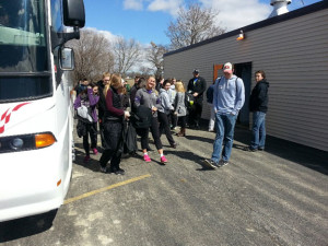 University of St. Thomas students get off at the first stop of their Mystery Service Tour.
